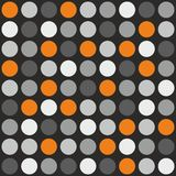Tile vector pattern with grey, white and orange polka dots on grey background Stock Image