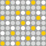 Tile vector pattern with grey, white and yellow polka dots on grey background Royalty Free Stock Image