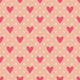 Tile vector pattern with hearts and polka dots on pastel pink background Stock Images