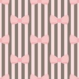Tile vector pattern with pink bows on brown and white strips background Royalty Free Stock Photography