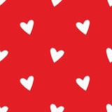 Tile vector pattern with white hearts on red background Stock Images