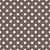 Tile vector pattern with white polka dots on brown background. Royalty Free Stock Photo