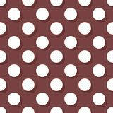 Tile vector pattern with white polka dots on a dark brown background Royalty Free Stock Photography