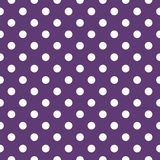Tile vector pattern with white polka dots on dark violet background Royalty Free Stock Image