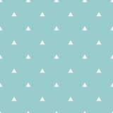 Tile vector pattern with white triangles on pastel blue background Royalty Free Stock Images