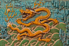 Tile wall with Chinese dragon Royalty Free Stock Images