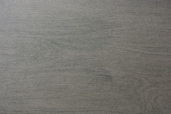 Tile wooden texture. A gray floor tile with wooden structure royalty free stock images