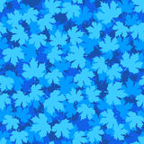 Tileable background with blue winter maple leaves Royalty Free Stock Photography