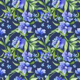 Tileable Floral Texture on Blue Background Royalty Free Stock Photos