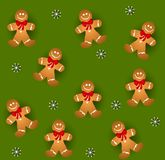 Tileable Gingerbread Men. A background pattern featuring tileable gingerbread cookies wearing bows with white snowflakes on green Stock Photography