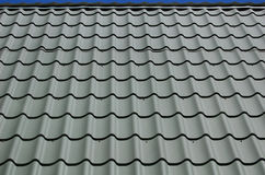 Tileable Roof. Green-Gray Tileable Roof Over Sky Royalty Free Stock Images