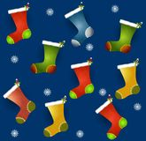 Tileable Xmas Stockings. A tileable background featuring Christmas stockings with snowflakes on blue background Stock Photography