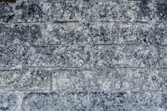 Tiled ancient stone wall as background and copy space Stock Photography