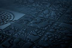 Free Tiled Bathroom Floor Covered With Big Water Drops In Various Sizes. Shower Cabin Floor And Drain Royalty Free Stock Image - 159134256