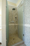 Tiled Bathroom Shower. With stone tiles. Home interiors Stock Images