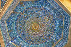 The blue dome of Madraseh-ye Khan, Shiraz, Iran. The tiled blue dome of Madraseh-ye Khan is covered with complex floral patterns and surrounded by calligraphic stock photography