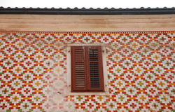 Tiled Building in Koper. A window in a old building in Koper which is beautifully tiled on its exterior Stock Photography