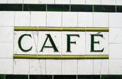 Tiled Cafe Sign. A sign for a cafe made from ceramic tiles outside a former tea shop in North London.  Viewed from public pavement Royalty Free Stock Photos