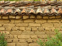 Tiled Clay Bricks Wall Rustic Style. Brickwork. Tiled Clay Bricks Wall Texture Background Rustic Style. Brickwork. Clay bricks wall covered with tiles. Rustic royalty free stock images