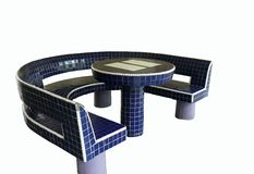 Tiled concrete chess table and bench. Tiled concrete chinese chess table and bench Royalty Free Stock Images
