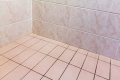 Tiled Corner. Interior close-up photo of bathroom tiled walls and floor Royalty Free Stock Photos