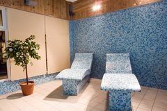 Tiled couches in spa. A view of blue tiled couches or lounge chairs in a spa Stock Images