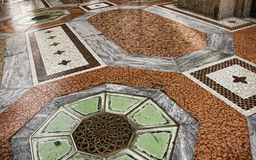 Tiled floor. Photo of the medieval tiled floor with decorative patterns Stock Image