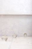 Tiled floor with glass spheres Royalty Free Stock Photos