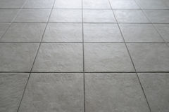 Tiled Floor. Gray Tiled Floor in Building Royalty Free Stock Photos