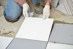 Tiled Floor Installation Royalty Free Stock Photos
