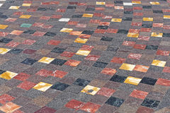 Tiled floor. Various color granite and marble floor tiles Stock Photo