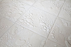 Tiled Floor and water droplets Royalty Free Stock Photography