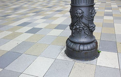 Tiled ground and historic pillar with ornaments Stock Photography