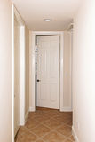 Tiled hallway with doors Royalty Free Stock Photography