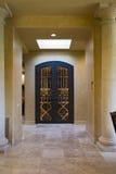 Tiled Hallway Towards Closed Doors Stock Photography