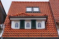 Tiled mansard roof of medieval building in Bremen, Germany. Stock Photos