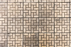 Tiled mosaic concrete pavement of the roadม Seamless texture of paving stones. Brow tile background. Royalty Free Stock Photography