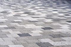 Tiled mosaic concrete pavement Stock Images