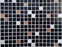 Tiled mosaic on the wall royalty free stock photography