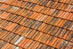 Tiled orange roof of the old house.  stock photography