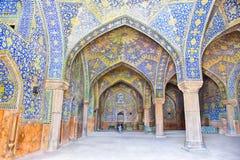 Tiled orienta on Jame Abbasi mosque, Esfahan. Tiled oriental arcs and pillars on Jame Abbasi mosque, Esfahan, Iran Royalty Free Stock Photography