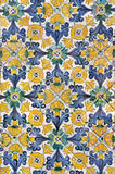 Tiled ornament. Tunisia. Kairouan - the Zaouia of Sidi Saheb (The Barber's Mosque). Fragment of ceramic tiled panel with floral and architectural motifs Royalty Free Stock Image