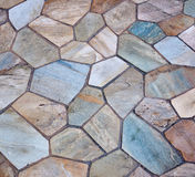 Tiled patio. Various stone pieces make up colorful tiled patio Stock Image
