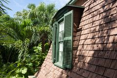 Tiled pitched roof. With the window in the attic stock image