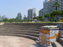 Tiled pot and exterior buildings in a park of Lima Royalty Free Stock Image