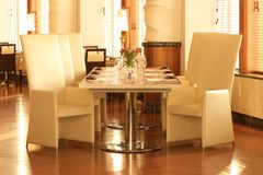Tiled restaurant table and chairs for six Royalty Free Stock Photo