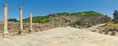 Tiled road to ancient amphitheater with columns Stock Photo