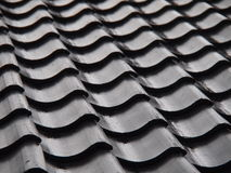 Tiled roof. Roof covered with black tiles Royalty Free Stock Photos