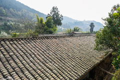 Tiled roof of aged farmhouses in mountain of spirng Stock Image