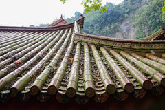 Tiled roof of ancient Chinese building in mountain Stock Photos